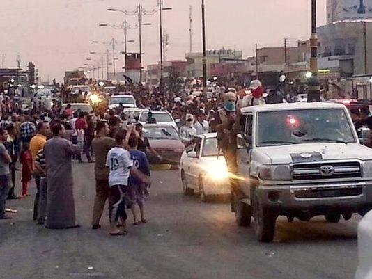 Rebels parade in Mosul (AP photo)