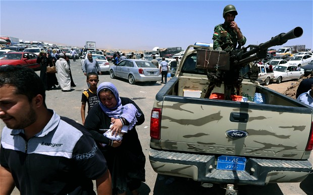 Iraqi families leaving Mosul following Sunni rebels takeover.
