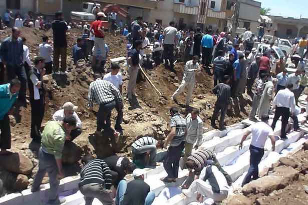 Mass burial for the victims of the Houla Massacre, Syria - May 29, 2012
