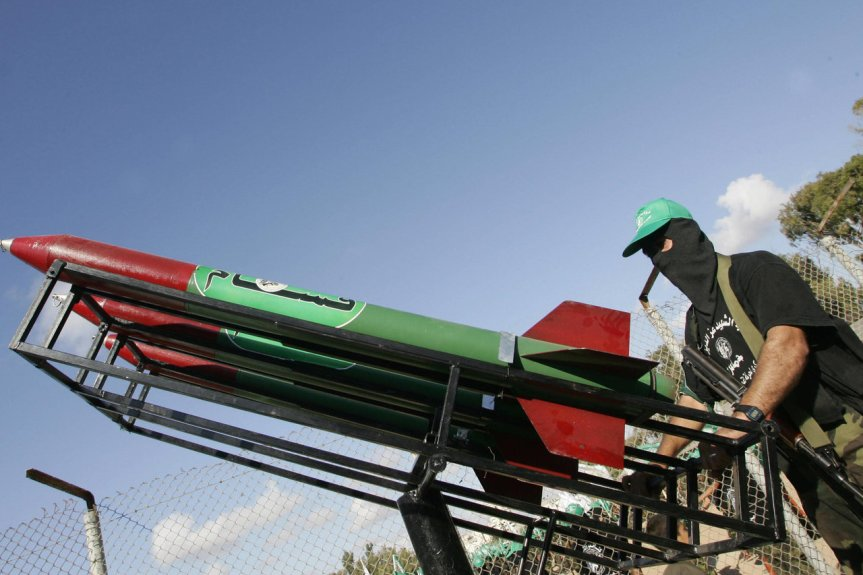 GAZA CITY:  A Palestinian militant from the Ezzedine al-Qassam Brigades, the military wing of the Islamic Resistance Movement Hamas, displays Qassam rockets during a rally in Gaza City 18 September 2005. (ABED/AFP/Getty Images)