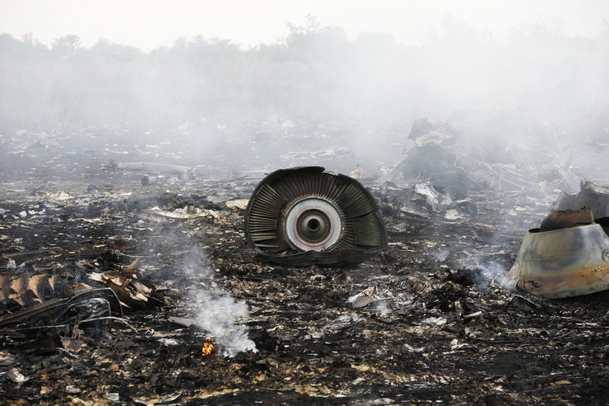 The debris of a jet engine from Malaysia Airlines flight MH17 is seen near the settlement of Grabovo in the Donetsk. (IMAGE: REUTERS/MAXIM ZMEYEV)