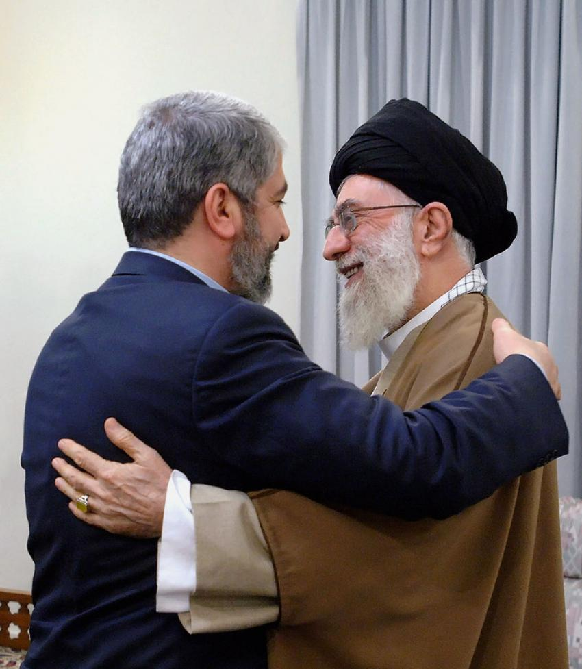 Iran's supreme leader Ayatollah Ali Khamneie (R) hugs leader of the Islamic group Hamas Khaled Meshaal before their meeting in Tehran, Iran on February 1, 2009. (UPI Photo/ HO/Iran's Supreme Leader's official website)