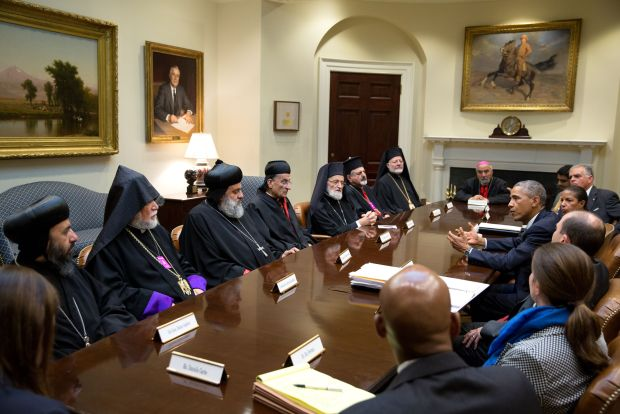 President Obama gestures during meeting with Lebanese cardinal and other religious religious leaders at White House