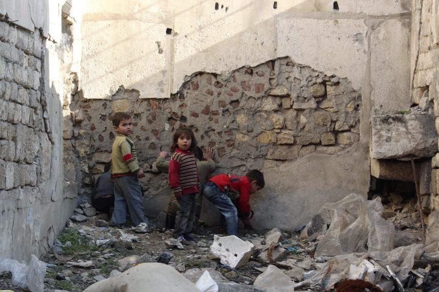 Children playing amidst the ruins in Aleppo, Syria