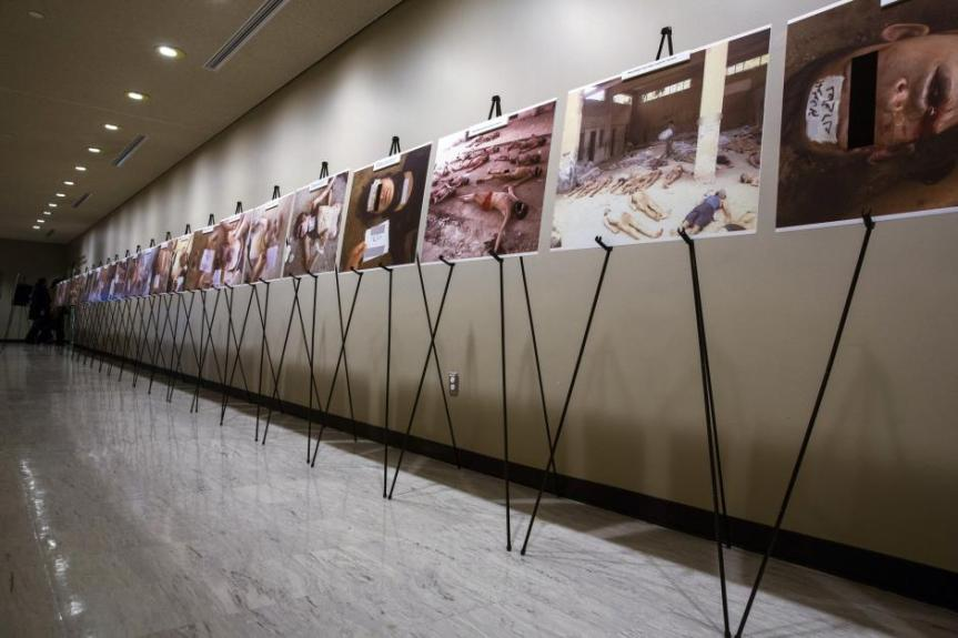 "The Syrian Genocide: A gruesome collection of images of dead bodies taken by a photographer, who has been identified by the code name ""Caesar,"" displayed at the United Nations Headquarters in New York, March 10, 2015. LUCAS JACKSON/REUTERS"