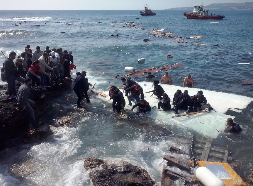 Migrants come to shore at Zefyros beach on the Greek island of Rhodes after their sailboat capsized on April 20. Most of the migrants managed to swim safely to the beach with the assistance of locals.